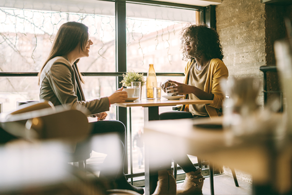 Two women talking at a coffee shop