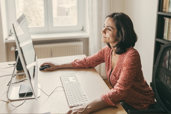 Woman working in home office on her compjuter
