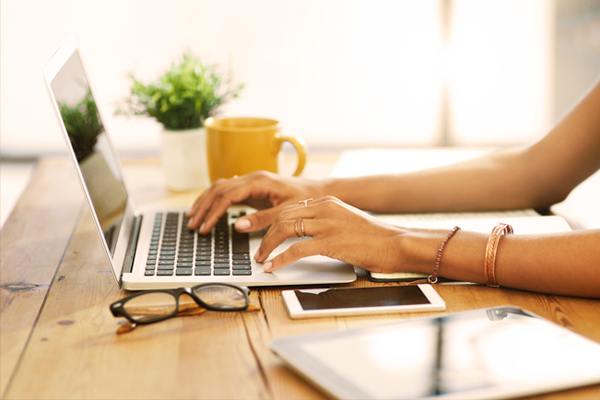 Photo of woman's hands at laptop